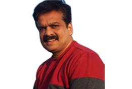 Adv.Dinesh Athrassery